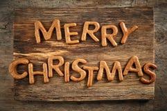 O pão-de-espécie exprime o Feliz Natal Fotografia de Stock Royalty Free