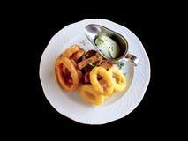 O pão fritado com alho, cebola e calamar soa Fotos de Stock