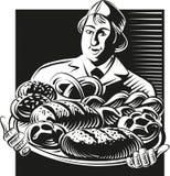O padeiro guarda tipos diferentes de pão recentemente cozido ilustração stock