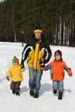 O pai com dois meninos Imagem de Stock Royalty Free