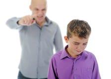 O pai estrito pune seu filho Imagem de Stock Royalty Free