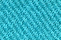 O pano de linho na cor de turquesa Textura do fundo da tela Detalhe de close-up do material de matéria têxtil fotos de stock