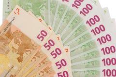 O papel às moedas do Euro ventila no fundo branco Foto de Stock