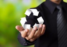 O papel recicla assina dentro a mão do homem de negócios Imagens de Stock Royalty Free