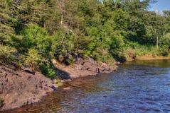 O parque estadual de um estado a outro é ficado situado no St Croix River por Taylo Imagem de Stock Royalty Free