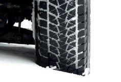 O passo todo-terreno do pneu da lama embalou com a foto do estoque da neve Imagem de Stock