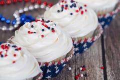 4o patriótico de queques da celebração de julho Imagens de Stock Royalty Free