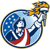 O patriota americano que guarda a tocha Stars a bandeira das listras Imagem de Stock