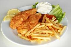O peixe e lasca dentro uma placa Foto de Stock Royalty Free