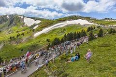O Peloton nas montanhas Imagem de Stock