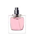 O perfume das mulheres na garrafa bonita isolada no branco Imagens de Stock Royalty Free