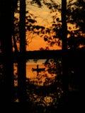 O pescador do por do sol Fotografia de Stock