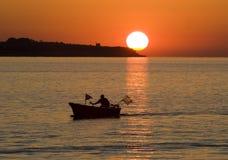 O pescador e The Sun imagens de stock royalty free