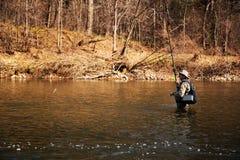 O pescador travou um timalo foto de stock