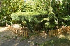 O pianista And His Piano recreou em Fern Sculpture fotografia de stock royalty free