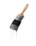 O pincel carregou com a cor cinzenta que goteja fora das cerdas Fotografia de Stock