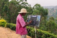 O pintor tira na natureza Fotos de Stock Royalty Free