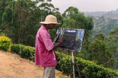 O pintor tira na natureza Imagem de Stock Royalty Free