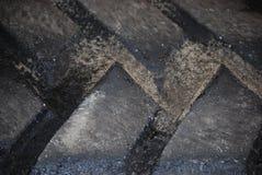 O pneu preto grande de Frontloader pisa o close-up Fotografia de Stock Royalty Free