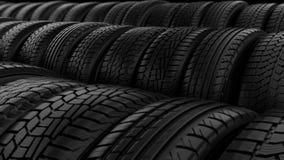 O pneumático do carro roda a luz do preto da noite do armazenamento filme