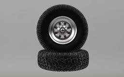 O pneumático offroad novo isolado no fundo cinzento 3d rende Fotos de Stock Royalty Free
