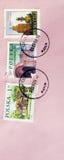 O polonês usado carimba o fundo cor-de-rosa Fotos de Stock Royalty Free