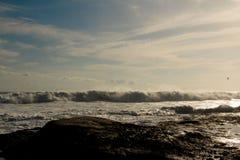 O por do sol dos oceanos imagem de stock