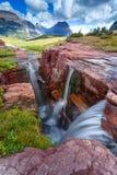 O por do sol triplicar-se cai no parque nacional de geleira, Montana, EUA imagens de stock