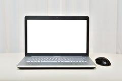 O portátil em um fundo claro Fotografia de Stock