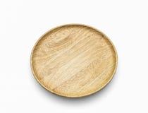 O prato de madeira no isolado branco Foto de Stock