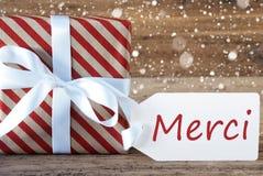 O presente com flocos de neve, meios de Merci do texto agradece-lhe Fotos de Stock Royalty Free