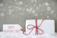O presente, fundo do cimento com Bokeh, Text o dia de Valentim feliz Imagem de Stock