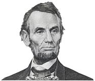 O presidente Abraham Abe Lincoln enfrenta o retrato em um iso de 5 notas de dólar fotos de stock