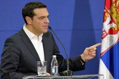 O primeiro ministro Alexis Tsipras de Grécia e o primeiro ministro sérvio Aleksandar Vucic guardam uma conferência de imprensa co imagens de stock