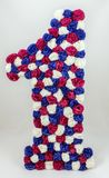 O primeiro número de flores artificiais imagem de stock royalty free