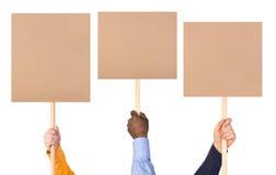 O protesto assina dentro as mãos imagens de stock royalty free