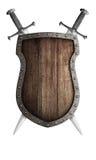 O protetor medieval de madeira velho e dois cruzaram espadas Imagens de Stock