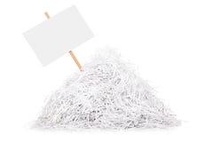 O quadro indicador colou em uma pilha do papel shredded Fotos de Stock Royalty Free
