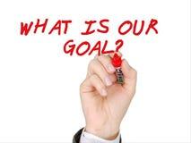 O que é nossa mão do objetivo escreva com marcador vermelho Imagens de Stock