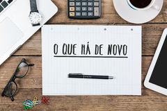 O que ha de novo, Portuguese text for What`s New on note pad  Royalty Free Stock Image