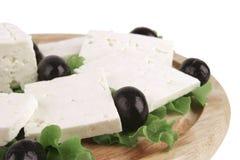 O queijo de cabra branco seriu na placa Foto de Stock