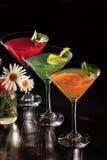 O quivi, a laranja e a cereja jelly com partes do cal nos vidros a Foto de Stock Royalty Free