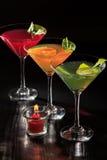 O quivi, a laranja e a cereja jelly com partes do cal nos vidros a Foto de Stock