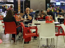 O.R. Tambo International Airport Johannesburg South Africa. Johannesburg South Africa - unidentified passengers enjoy a meal at fast food outlets at the O.R Royalty Free Stock Photos