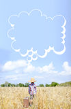 O rapaz pequeno ao lado valize com bolha do pensamento dentro Fotografia de Stock