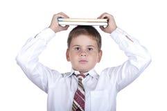 O rapaz pequeno com livros Foto de Stock