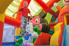 O rapaz pequeno em um trampolim Foto de Stock Royalty Free