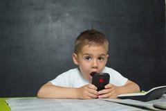 O rapaz pequeno gosta de um homem de negócios Foto de Stock Royalty Free