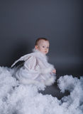 O rapaz pequeno gosta do anjo no céu Fotografia de Stock Royalty Free