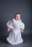 O rapaz pequeno gosta do anjo no céu Imagem de Stock Royalty Free